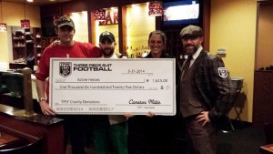 TPSF Boston members presenting a check to Captain Justin Fitch for $1,625 following the inaugural TPSF Boston game on May 31st, 2014